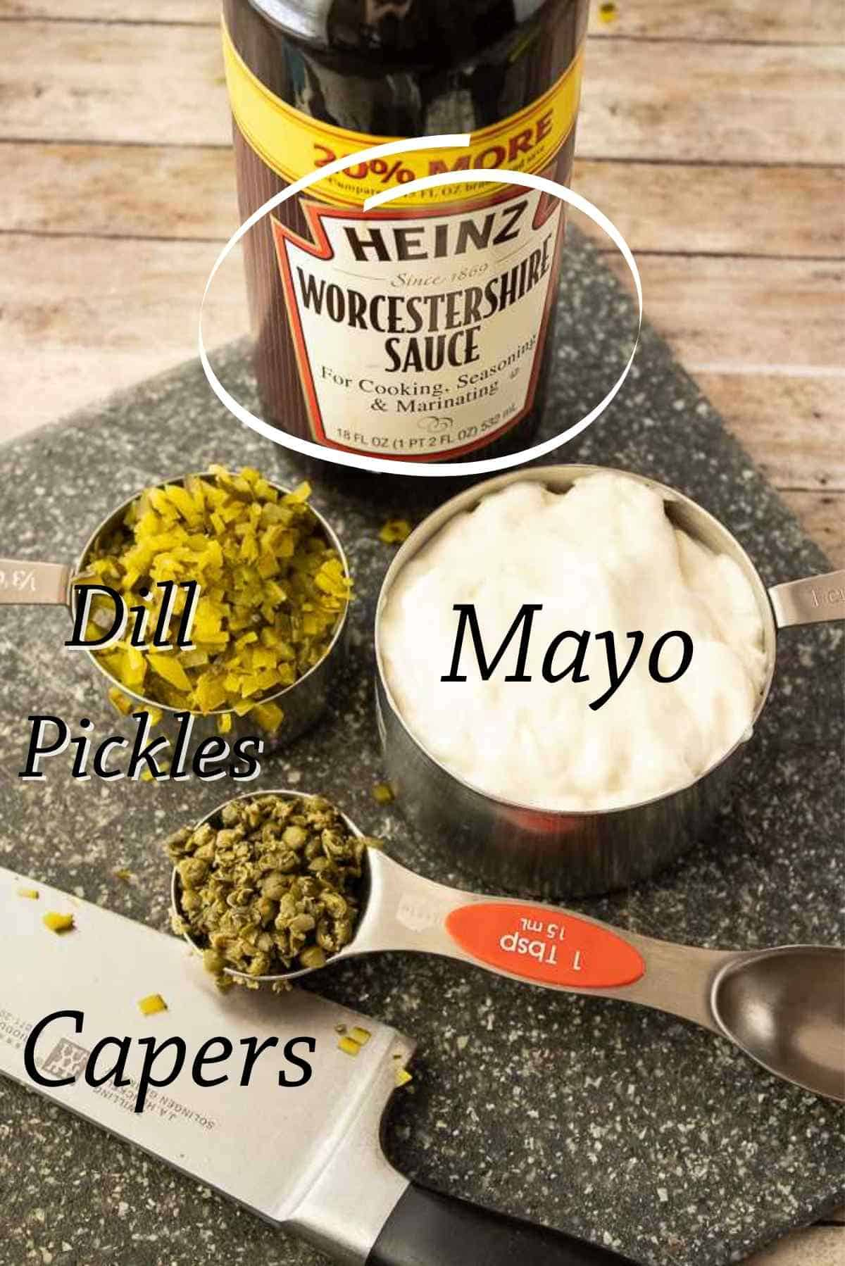 The four ingredients needed to make tartar sauce.