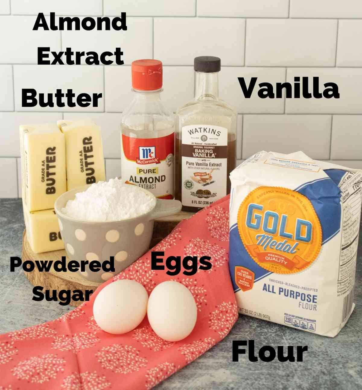 The six ingredients needed to make these sugar cookies.