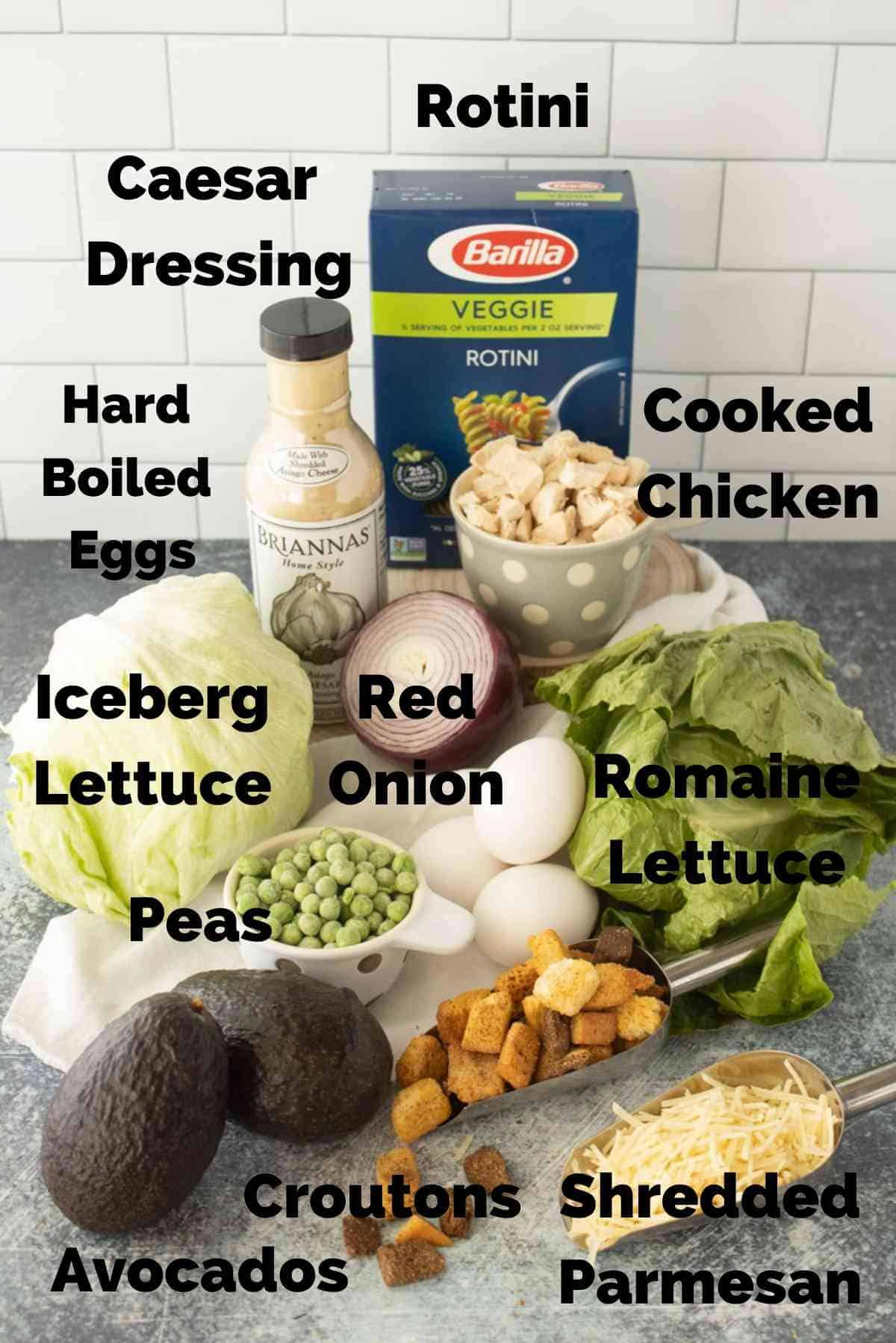 Lettuce, rotini, chicken, caesar dressing and other ingredients to make this dinner salad.