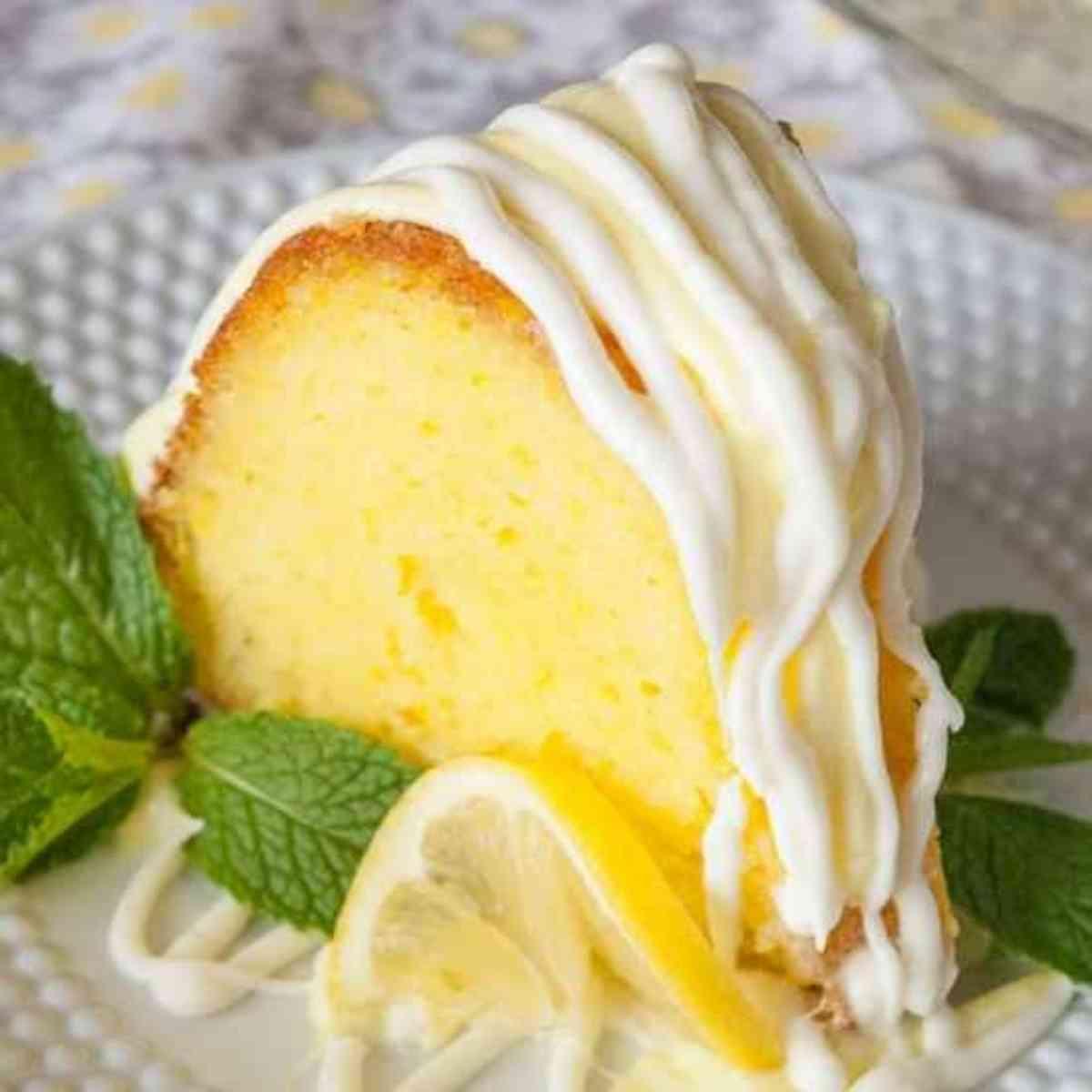 Slice of lemon bundt cake on a plate.