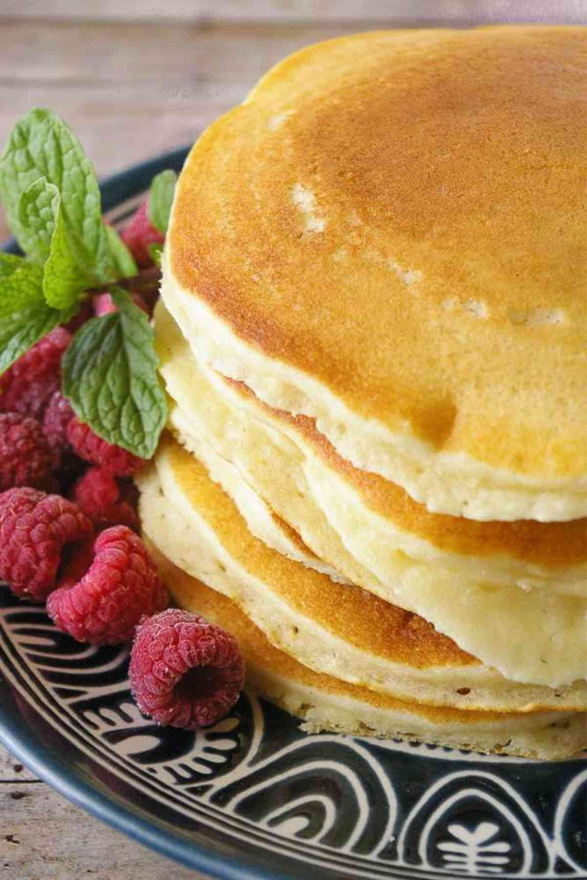 A hot stack of five fluffy buttermilk pancakes.