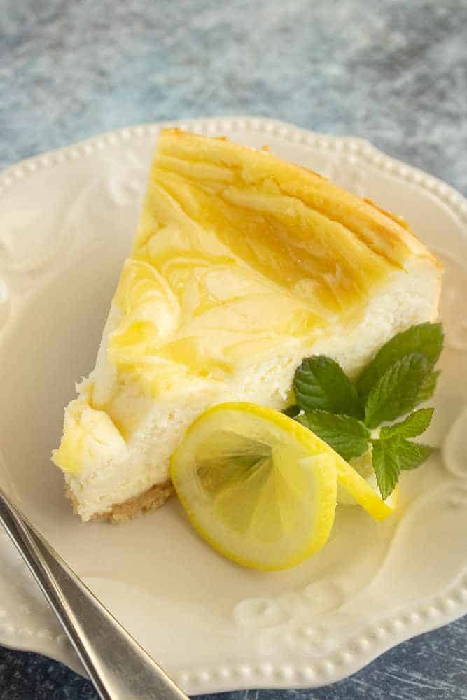 A slice of lemon swirl cheesecake.