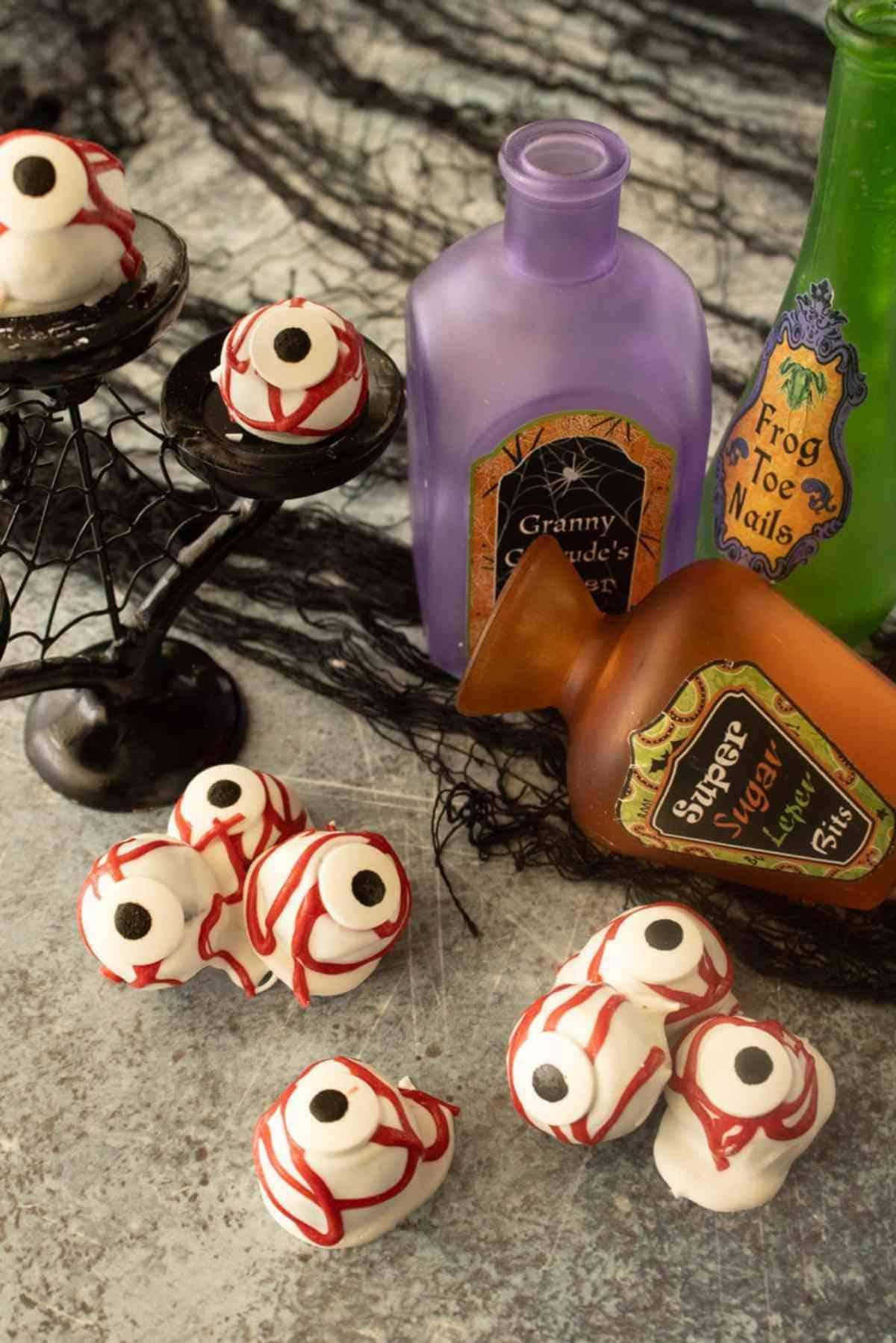 Scary Oreo eyeballs next to potion bottles.