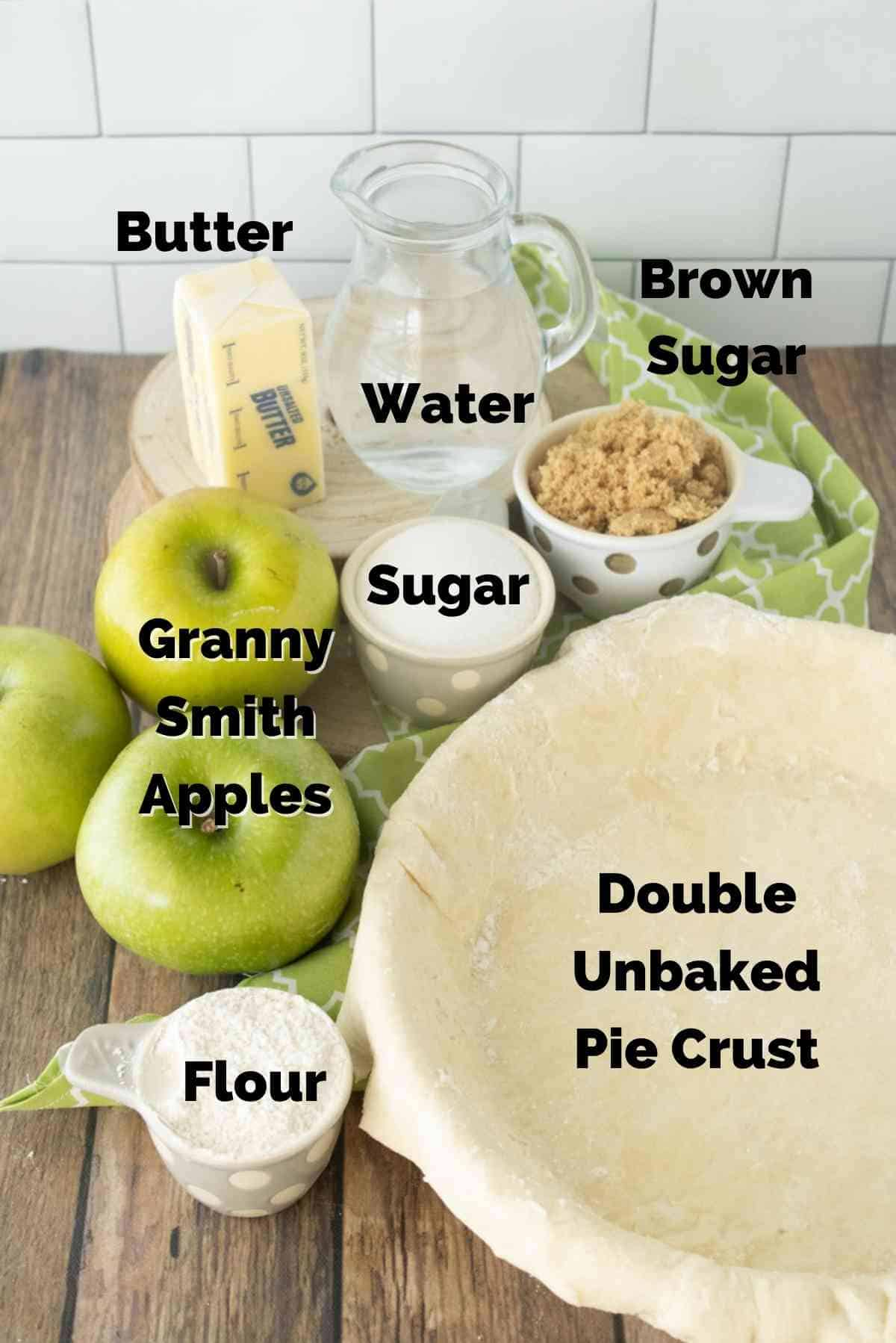 All you need is butter, sugar, brown sugar, water, flour, some granny smith apples and an unbaked pie crust for this pie!