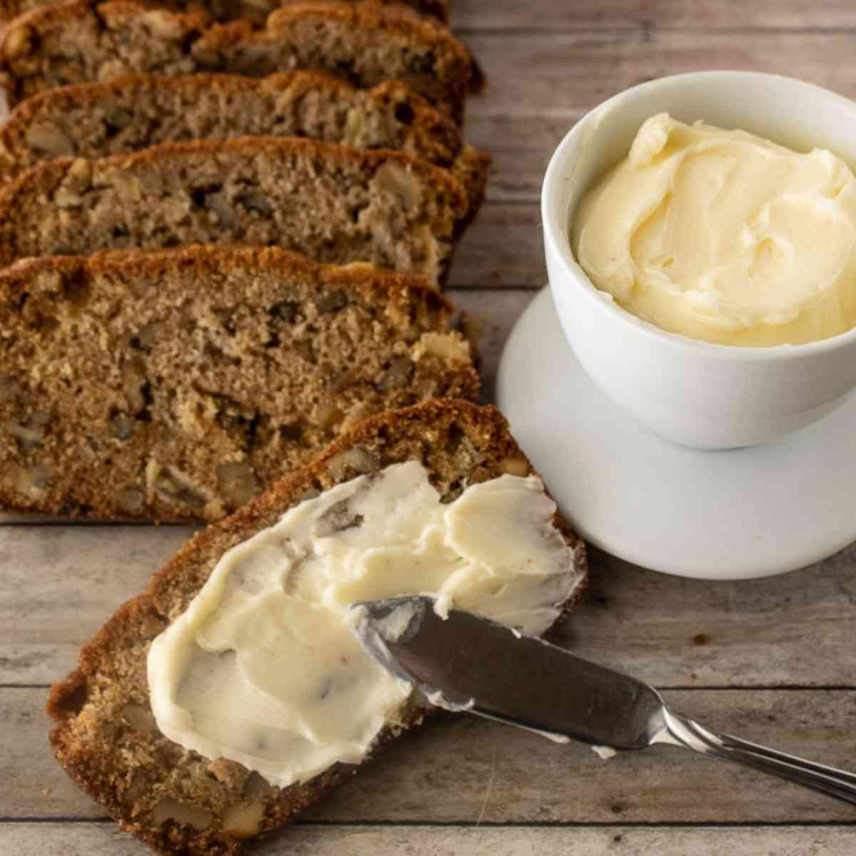 A buttered slice of fresh apple bread.