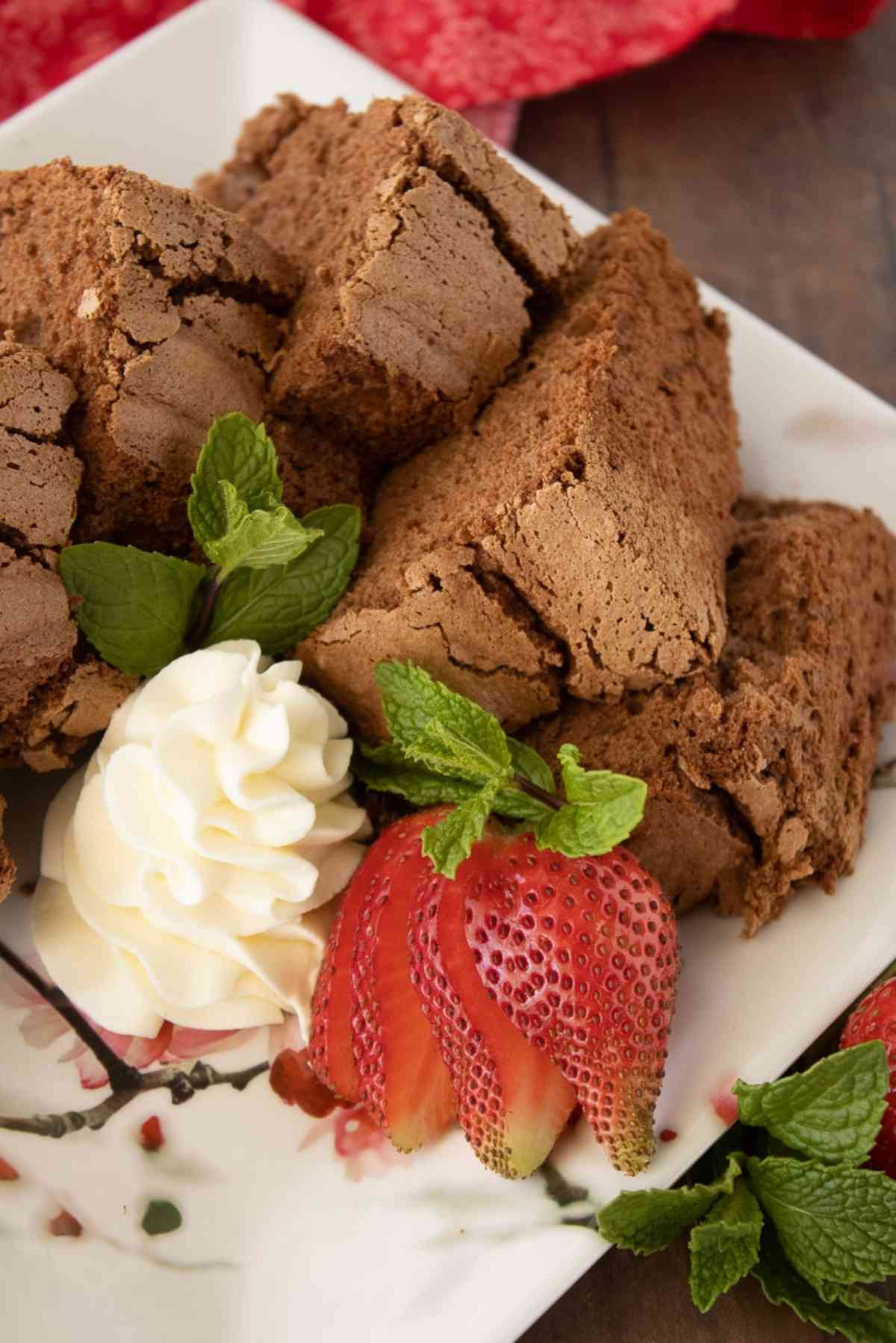 Wedges of chocolate angel food cake with fresh whipped cream.