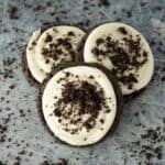 Three soft crumbl oreo cookies sprinkled with extra oreo crumbs.